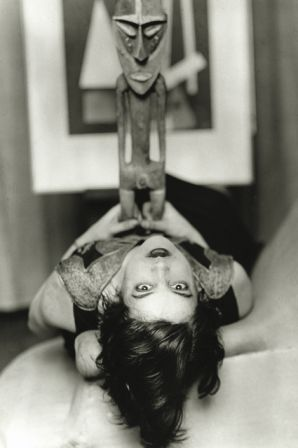 Man Ray. Simone Kahn (with Vanuatu male figure, eastern Malekula), c.1927. Modern print. Collection of Edmunde Treillard. © 2009 Man Ray Trust / Artists Rights Society (ARS), NY / ADAGP, Paris