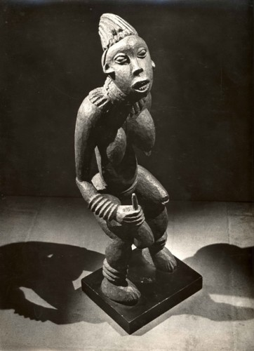 "Man Ray. Untitled (Bamileke figure, njuindem, ""Bangwa Queen,"" Bangwa Kingdom, Cameroon), c. 1934. Gelatin silver print. Private collection, Paris. © 2009 Man Ray Trust / Artists Rights Society (ARS), NY / ADAGP, Paris"
