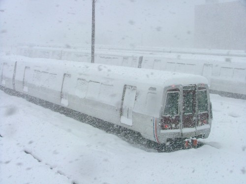 Snow covers trains at Metro's Brentwood Yard (courtesy of WMATA)