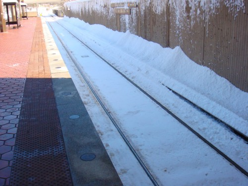Snow covered trackbed and third rail at West Falls Church Station (courtesy WMATA)