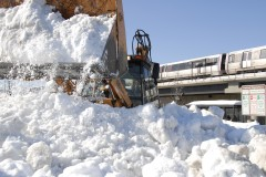 A frontloader clears snow at the Rhode Island Ave - Brentwood Metro station (courtesy Larry Levine/WMATA)