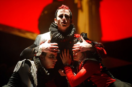 "Alex Mills, Philip Fletcher and Irina Tsikurishvili as Iago in Synetic Theater's production of ""Othello."" Photo credit: Graeme B. Shaw"