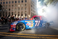 NASCAR driver Landon Cassill does a burnout in front of the VA Department