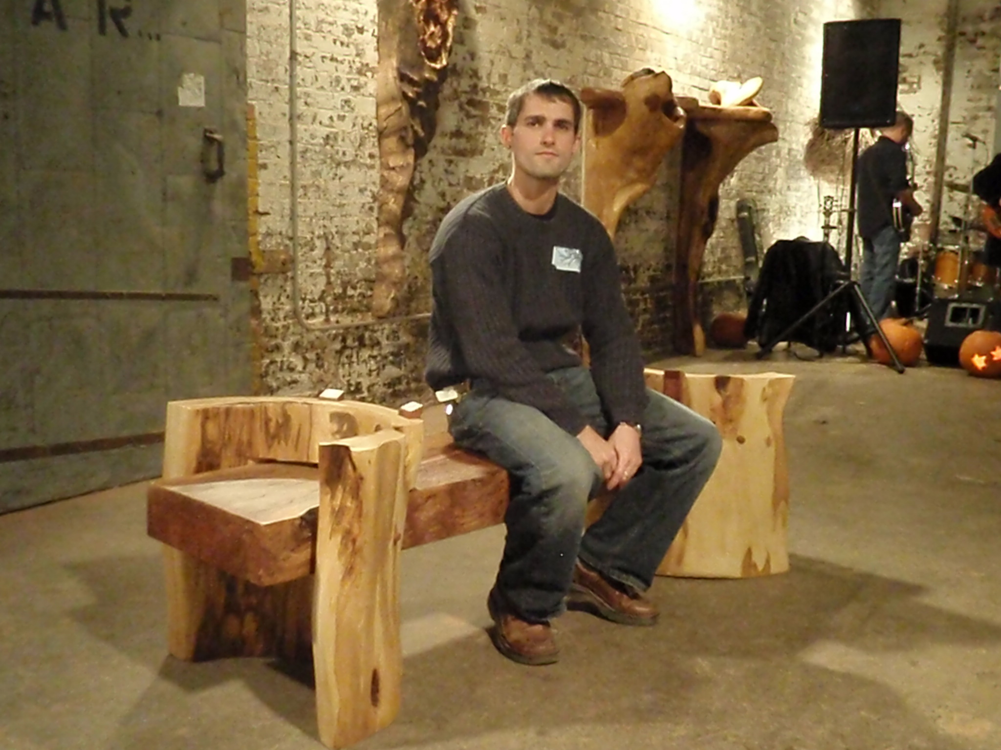 bench in sycamore and linden uprights with nate lucas demonstrating one of many uses.