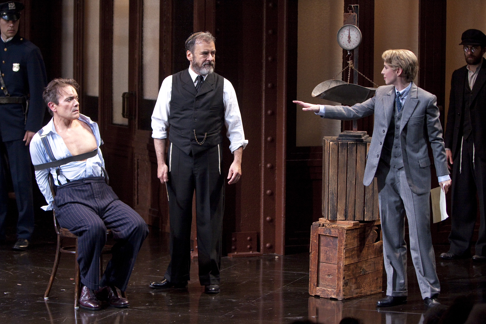 Derek Smith as Antonio, Mark Nelson as Shylock and Julia Coffey as Portia in the Shakespeare Theatre Company's production of The Merchant of Venice, directed by Ethan McSweeny. Photo by Scott Suchman.
