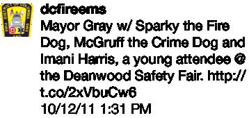Mayor Gray w/ Sparky the Fire Dog, McGruff the Crime Dog, etc.