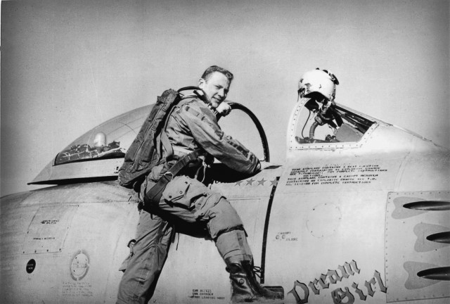 Buzz Aldrin climbs into his F-86 Sabre Jet in Korea, circa 1952. ( Photo used by permission from the Buzz Aldrin Photo Archive  and National Geographic)