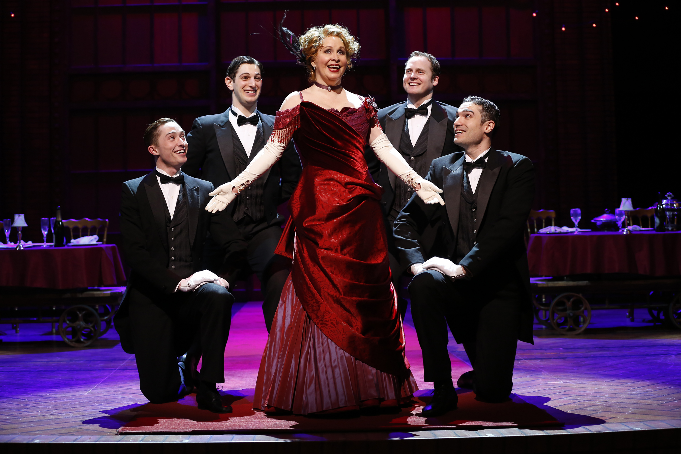 "Nancy Opel as Dolly Levi with Jp Qualters, Harris Milgrim, Kyle Vaughn and Alex Puette in the Ford's and Signature Theatre co-production of ""Hello, Dolly!"" Photo by Carol Rosegg."