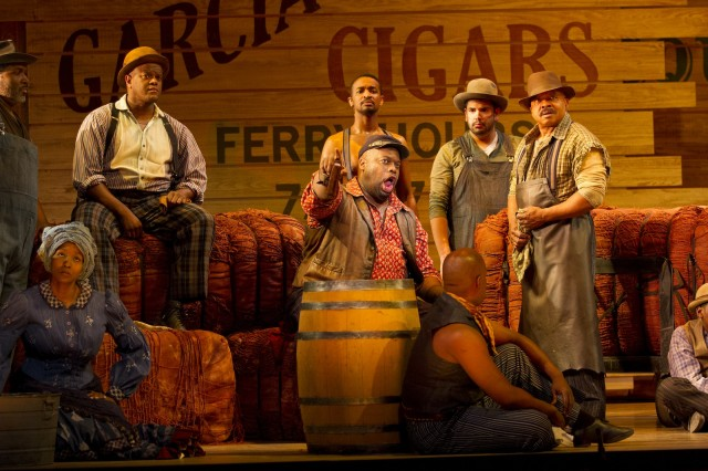 Morris Robinson as Joe (center, in red shirt) and the company of Show Boat. Photo by Scott Suchman.