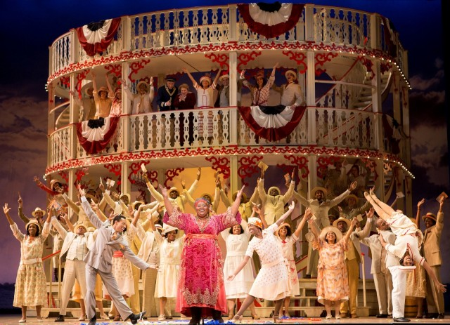 Angela Rene Simpson as Queenie (center, in pink dress) and the company of Show Boat. Photo by Scott Suchman.