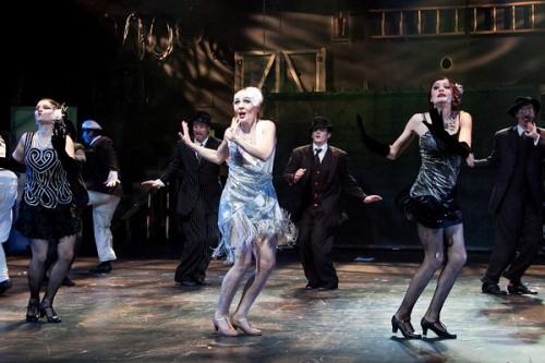 Irina Tsikurishvili as Viola with Ensemble in Synetic Theater's Twelfth Night. Photo: Koko Lanham.