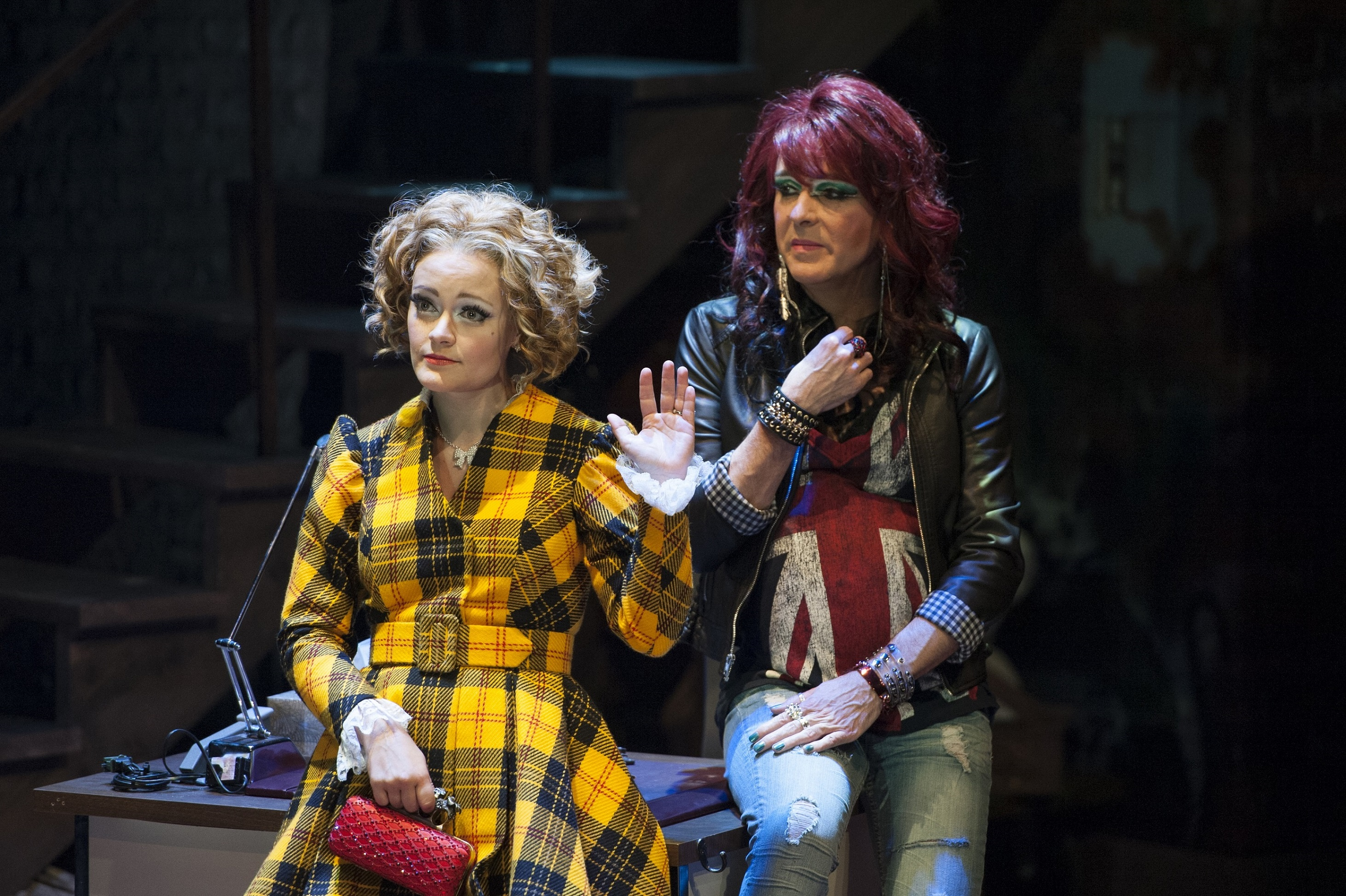 "Polly Peachum (Erin Driscoll) and Lucy Brown (Rick Hammerly) vie for the love of Macheath in ""The Threepenny Opera,"" now playing at Signature Theatre through June 1, 2014. Photo by Margot Schulman."
